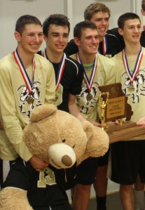 Senior, Ryan Gettinger  (Far Left) holds the LHS Bear as the team took a picture with the trophy.